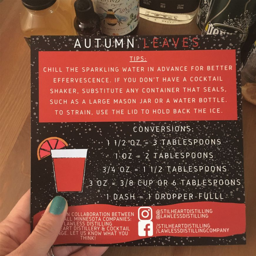 Hand holding Autumn Leaves cocktail kit instruction card