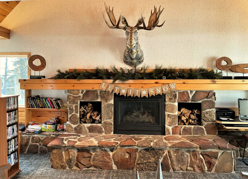 Fireplace with a mounted moose head