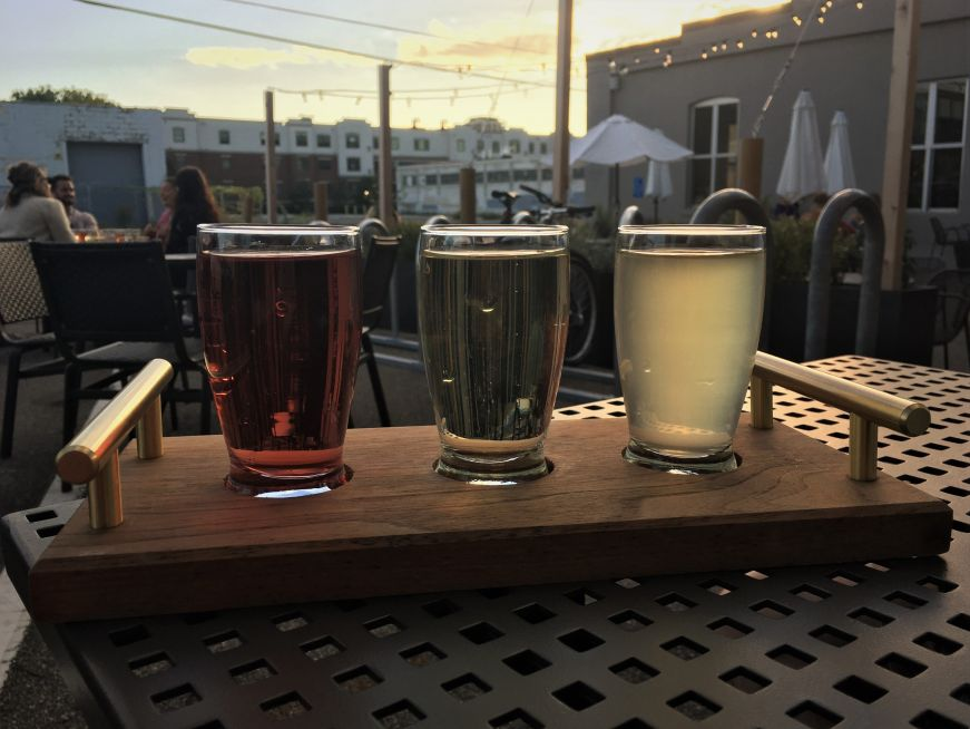 Cider flight with patio lights in the background