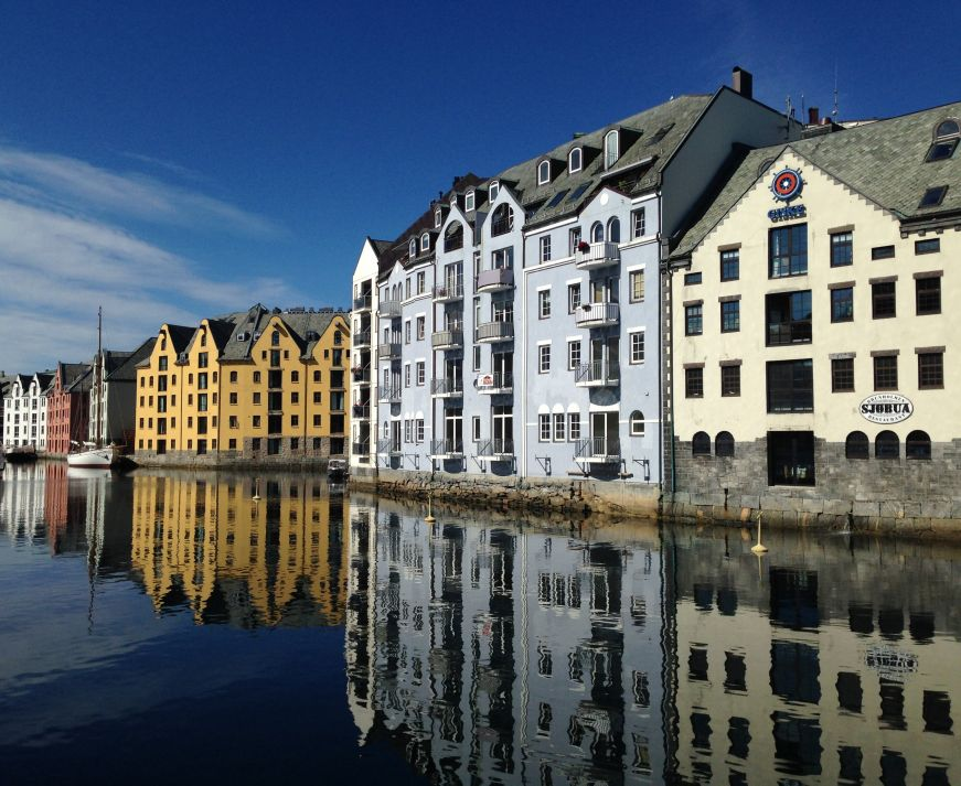 Colorful warehouses in Alesund harbor