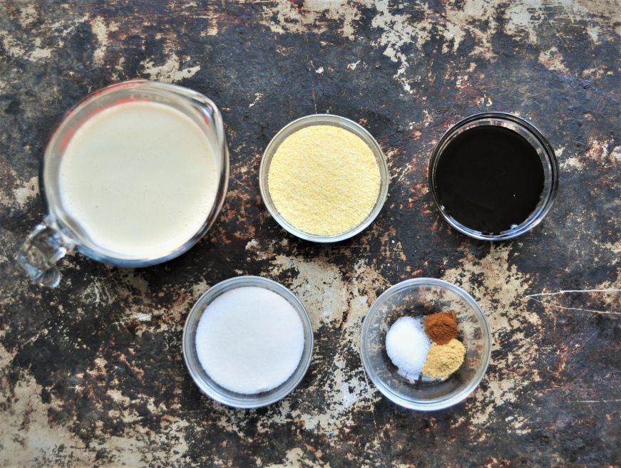 Measured ingredients for cornmeal molasses pudding
