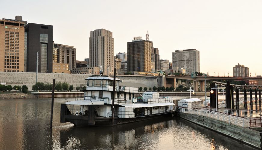 Houseboat on the Mississippi River with the St. Paul skyline in the background