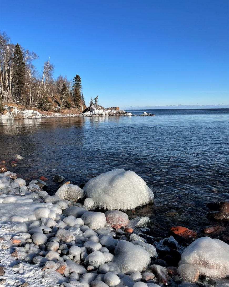 Rocks coated with ice along the shore of Lake Superior