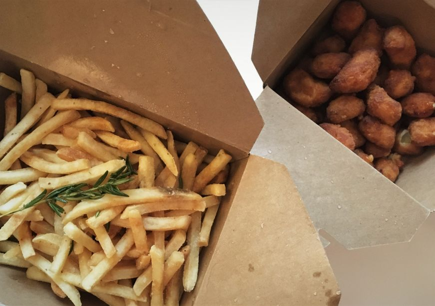 Takeout boxes of rosemary-salted fries and cheese curds