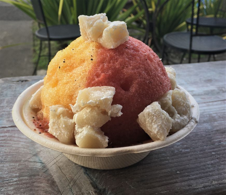 Cup of yellow and pink shave ice topped with cubes of mochi, Kula Shave Ice