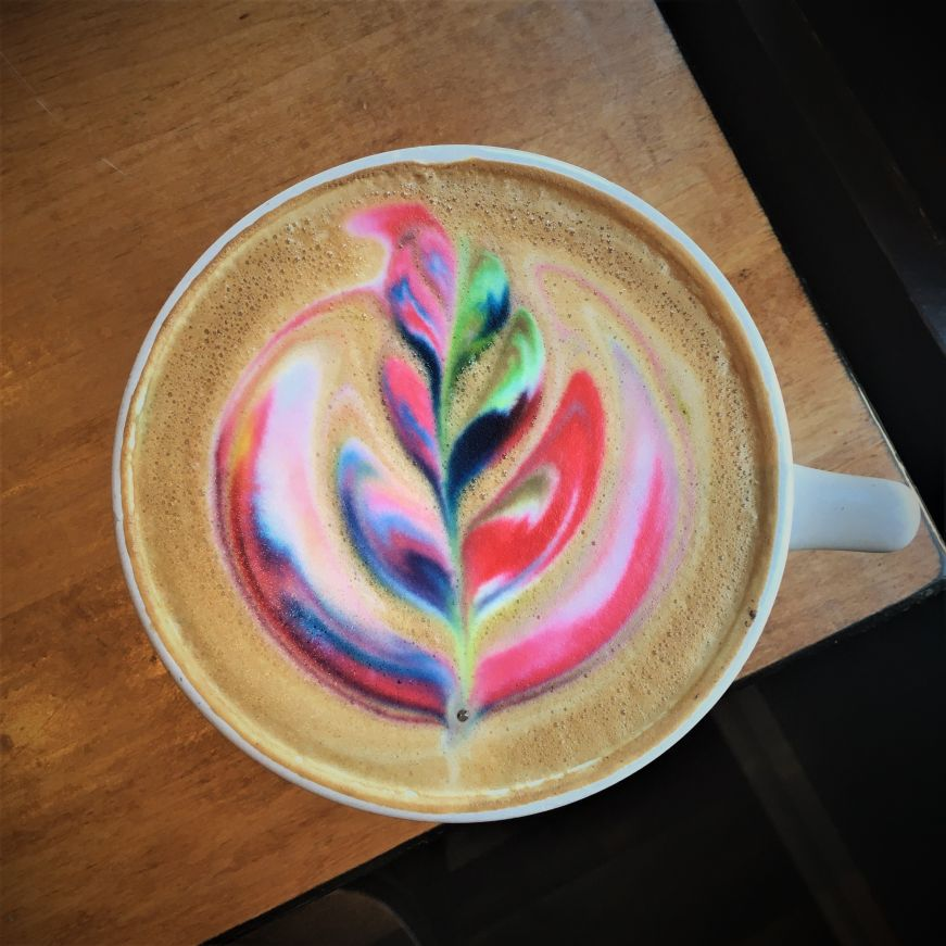 Latte with multi-colored latte art