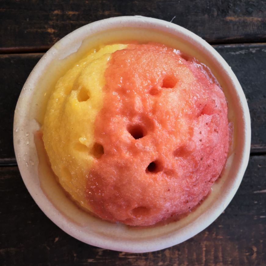 Cup of shave ice with mango, guava, and strawberry syrup, Kula Shave Ice, Hilo, Hawaii