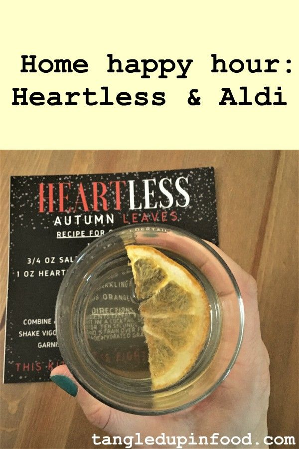 "Hand holding cocktail with text reading ""Home happy hour: Heartless & Aldi"""