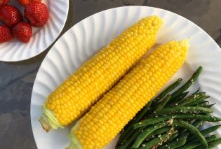 Strawberries, corn on the cob, and green beans