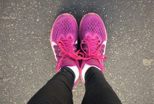 Stacy's feet in magenta running shoes