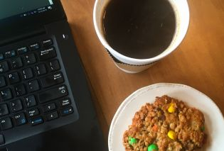 Top down view of laptop keyboard, coffee, and oatmeal M&M cookie, The Wired Robin, Hudson