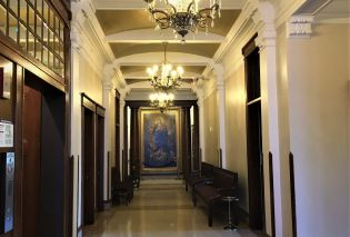 Hallway with crystal chandeliers and oil painting